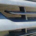 Расстояние между радиатором и решёткой