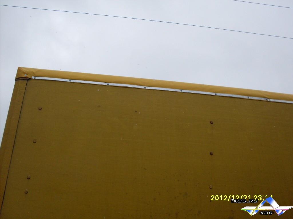 После ремонта крыши фургона тентом.